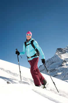 Austria, Woman skiing on mountain at Salzburger Land