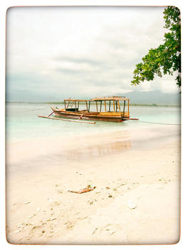Indonesia, Gili Islands, Beach with traditional fishing boat