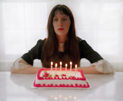 Sad Looking Woman With Birthday Cake