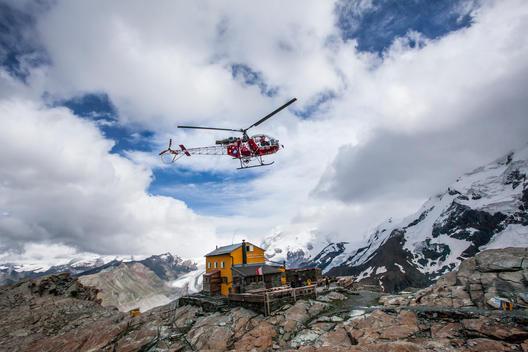 Air Zermatt passing by Gandeggh?_tte and going to a rescue on the Matterhorn