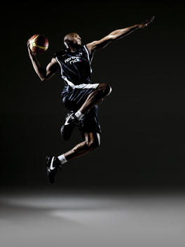 Basketball Player Jumping In Air, Prepared To Dunk