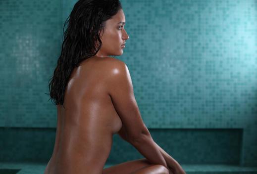 back shot of dark skinned woman in spa