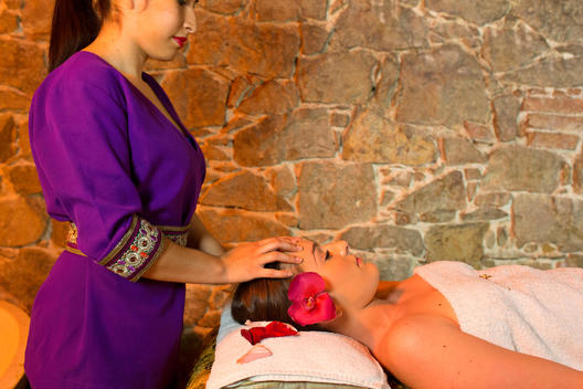 Female Massage Therapist Giving Woman Head Massage