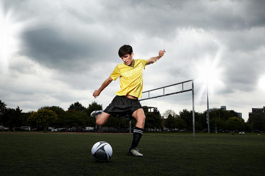 Soccer Player About To Kick Ball On Pitch