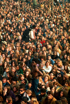 People wait in a crowd Altamont, California, Rolling Stones concert 1969