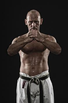 Germany, Bavaria, Mature man doing karate, portrait