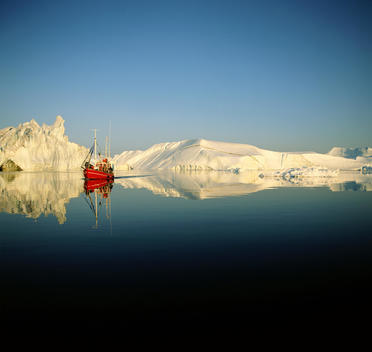 Fishing boat in icy waters, Disko Bay, Greenland