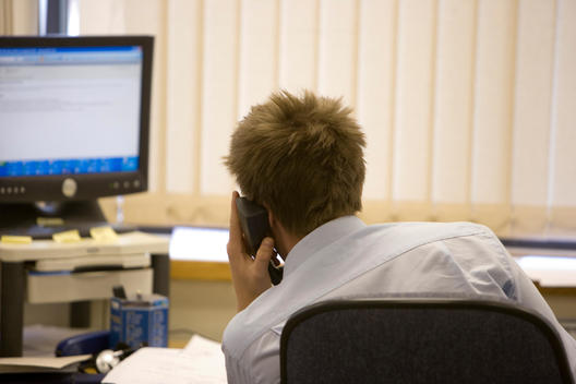 Young Man On Telephone Office Environment