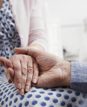 Senior Couple Holding Hands, Close Up