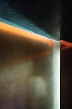 Detail of light installation on a colour loop between metal wall and ceiling
