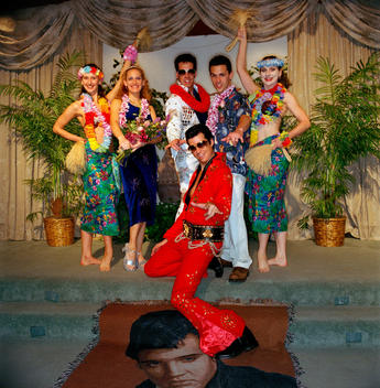 Husband, Wife And Bridal Party Pose For Wedding Photos After Their Blue Hawaiian Themed Wedding Where They Were Married By Elvis At The Viva Las Vegas Wedding Chapel On Valentines Day.