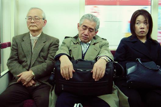 People Sitting Inside The Metro In Tokyo, Japan.