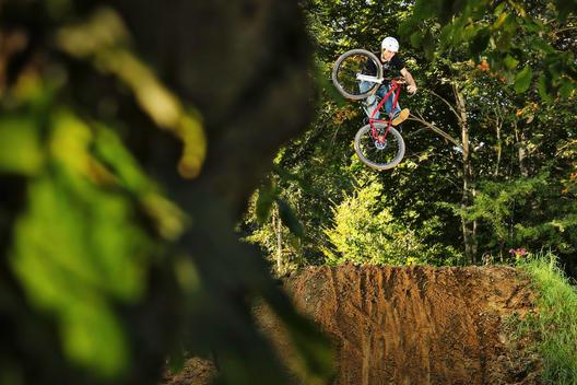 BMX rider performing stunt mid air