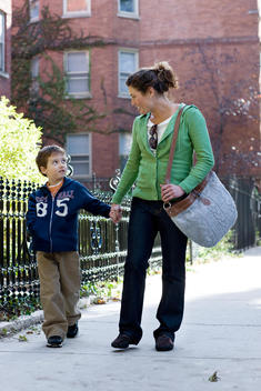 A Mother And Son Walk Down A Residential Chicago Street On A Summer Day.