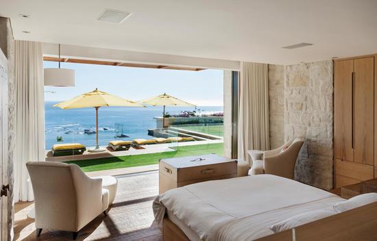 Bedroom overlooking patio and ocean