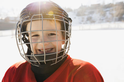 Portrait of smiling boy in ice hockey helmet