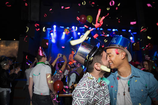Homosexual couple kissing at New Year celebration