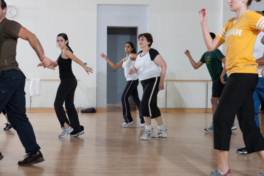 Gym Members Work Out In The Tango Salsa Caliente Class At The Holmes Place Health Club.