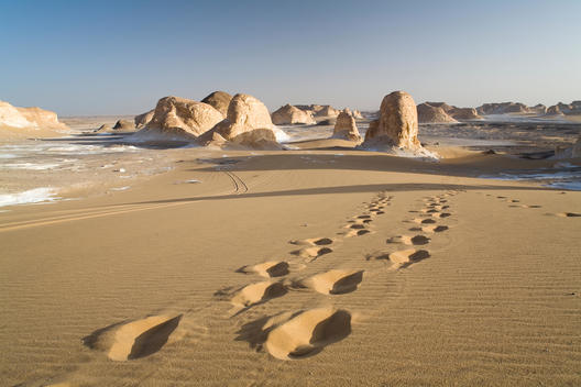 Footsteps Leading To Rock Formations At The Entrance To The White Desert