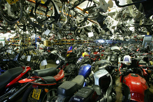 lots of motorcycles inside building
