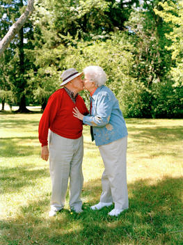 Senior Couple Kissing Outside.