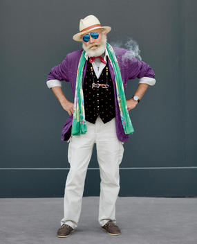 Senior Man Smoking And Wearing A Bizarre Outfit, Florence, Tuscany, Italy.