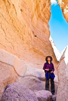 Japanese woman exploring rock formations, Santa Fe, New Mexico, United States