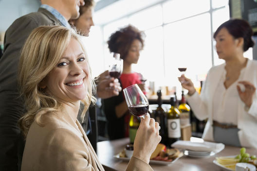 Sommelier and couples wine tasting in store