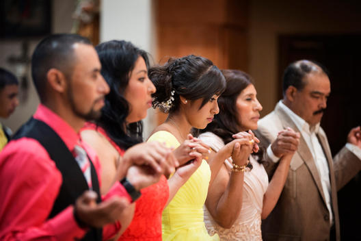Hispanic community celebrating quinceanera in Catholic church