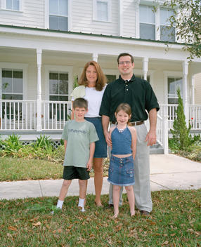 Family Outside Their Home