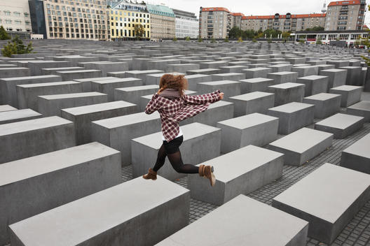 Girl Jumping On Holocaust Memorial, Berlin, Germany