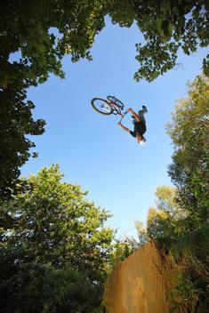 BMX rider upside down mid air