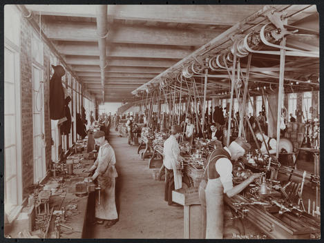 Automobile Factory At Kingsland Point, Hudson River (Near Tarrytown, Ny) Rows Of Work Stations In Machine Shop With Steam-Powered, Belt-Driven Machinery, And Laborers.