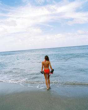Woman In Bikini Walking To Sea