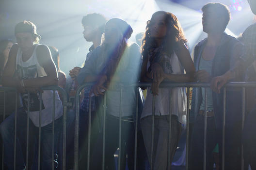 Crowd leaning on railing at concert