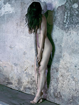 Nude woman with torture device