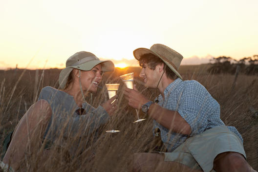 Couple drinking wine on safari, Stellenbosch, South Africa
