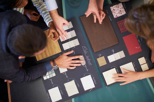 Group of people discussing about color samples