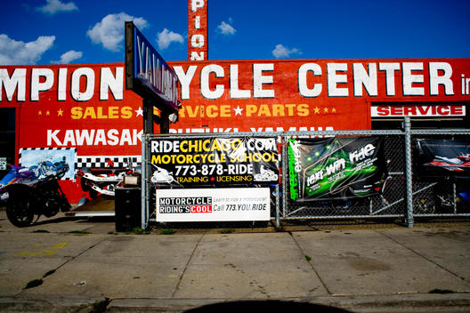 Street view of a motorcycle repair shop.