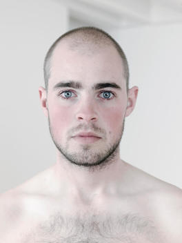 Portrait Of Shirtless 20 - 25 Year Old Man Of Caucasian Appearance