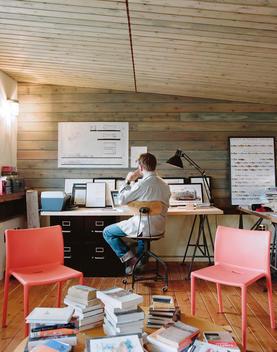 Man Sitting In A Home Office Loft.
