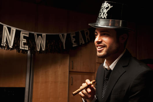 Hispanic man wearing hat for New Year\'s Eve