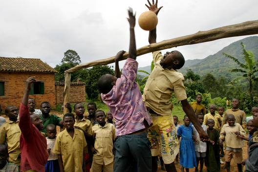 A group of students play volleyball with a make-shift net at a catch-up school in Rwanda, East Africa. The school is for children who missed part of their education due to the genocide in 1994. 10th anniversary of the Rwandan Genocide, April 2004. Part of