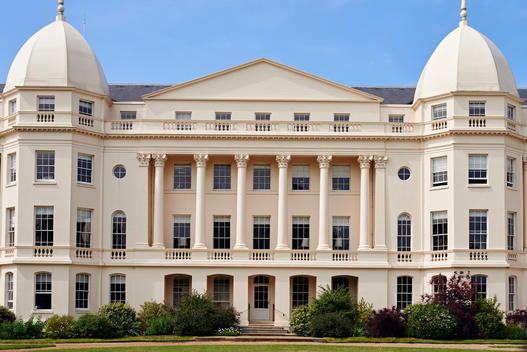 Classical symmetrical architectural design building in sunny daylight