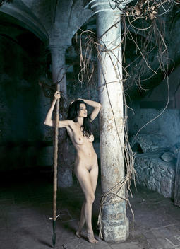 Nude woman holding spear