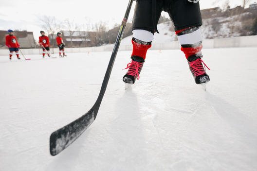 Low section of ice hockey player on rink