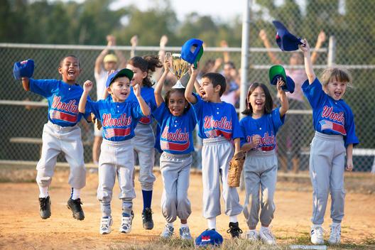 Baseball team cheering on field