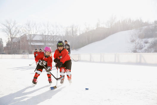 Young ice hockey players practicing on rink