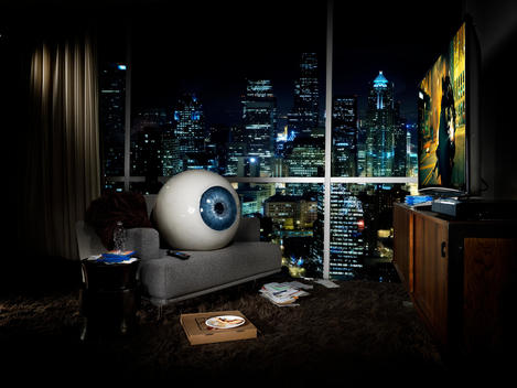 giant eyeball in apartment room, advertisement for blu-ray technology
