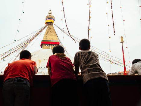 Nepal, Kathmandu, Bodnath, Stupa sanctuary with prayer flags
